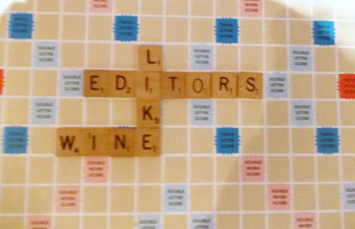 """Scrabble board with tiles spelling """"Editors like wine"""""""