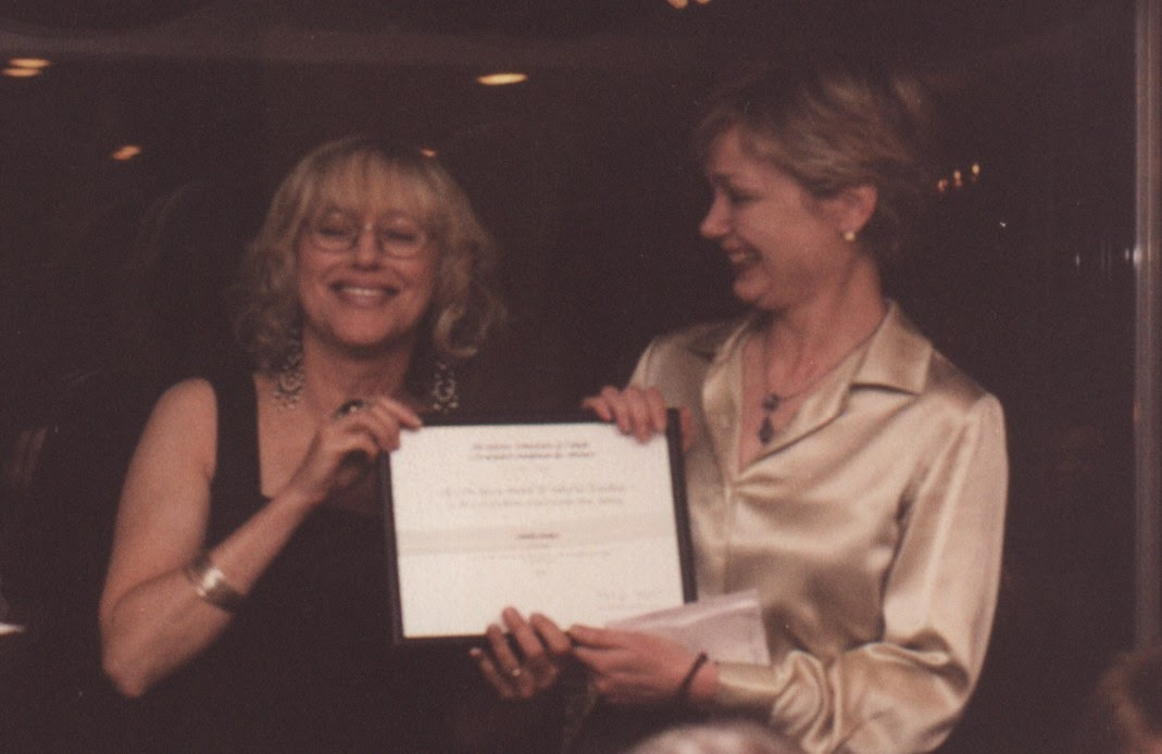 Nancy Flight presents the Tom Fairley Award to Camilla Blakeley at the 2002 Editors Canada conference