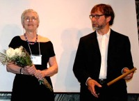 Lee d'Anjou presents the Lee d'Anjou Volunteer of the Year Award to Cy Strom
