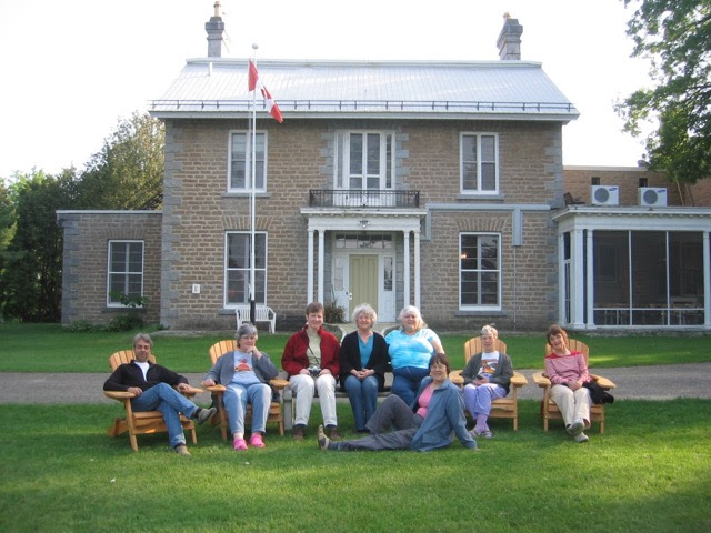 Members of the Editors Canada certification steering committee sit in Adirondack chairs at a June 2007 retreat