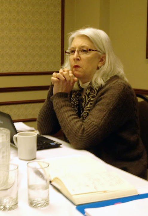 A member of the national executive council sits at a boardroom table at the NEC's February 2012 meeting